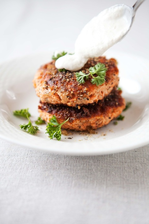 pepper salmon cakes adding sauce